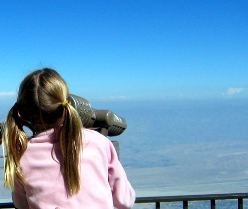 The World is your Oyster. Photo of young girl with telescope, my daughter Jackie (c) Kristin Espinasse, www.french-word-a-day.com