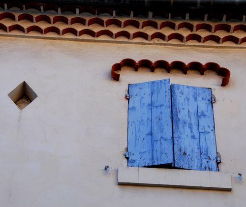 Diamond and blue window in Roquemaure, France (c) Kristin Espinasse