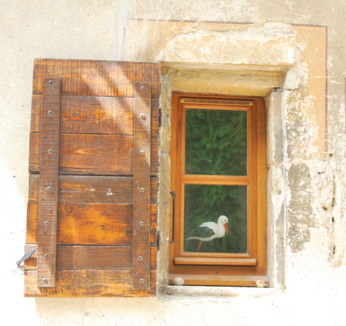 Window and stork in Grignan, France (c) Kristin Espinasse, visit french-word-a-day.com