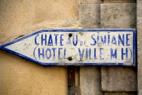 wooden signpost, France, chateau de simiane, blue, paint, hotel de ville, Valréa, Vaucluse, France (c) Kristin Espinasse www.french-word-a-day.Com
