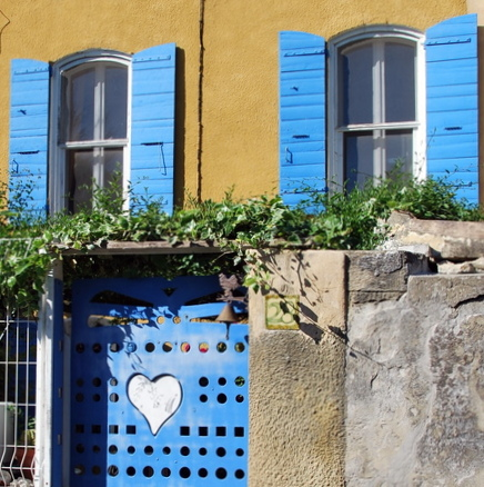 Hearts, window, shutters, blue, and France (c) Kristin Espinasse, www. french-word-a-day.com