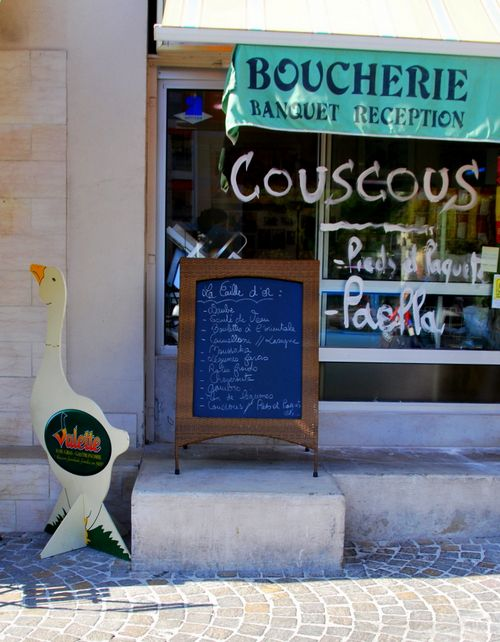 Cassis, France, and a goose, or oie, a boucherie, or butcher shop, and blackboard menu out front. Couscous for lunch www.french-word-a-day.com (c) Kristin Espinasse