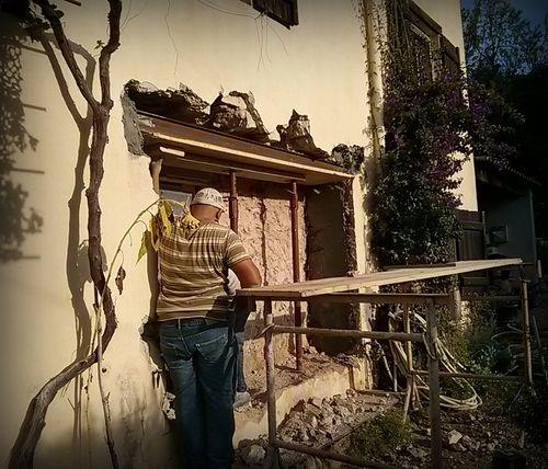 Lintel installation. Stone walls, bouganvillea, vine trunk, mason www.french-word-a-day.com (c) Kristin Espinasse