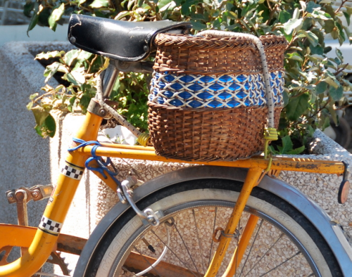 yellow bicycle wicker basket panier france french tire cord