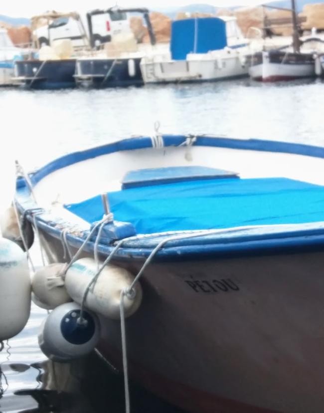 PETOU fishing boat or pointu in the port de la madrague St Cyr-sur-Mer France Var near the sentier littoral