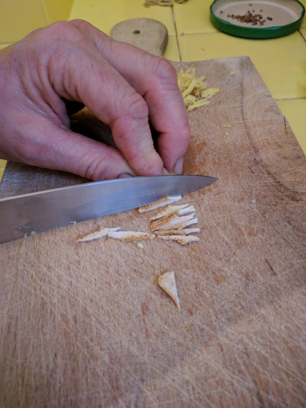 Slicing and mincing the ginger and lemon peel