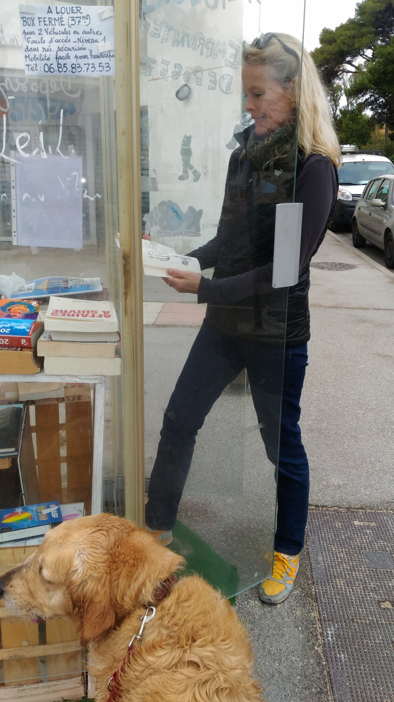 Telephone booth repurposed book lending giving library golden retriever smokey and kristi