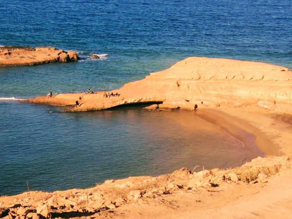 Nador Morocco fisherman beach red cap