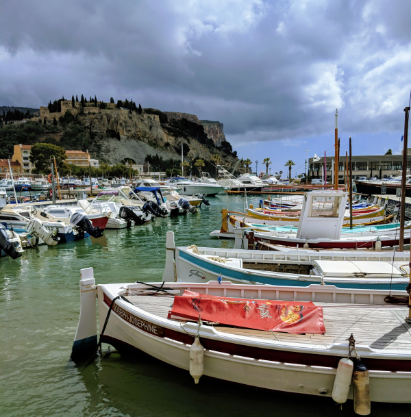 Old wooden fishing boats and le chateau de cassis hotel restaurant