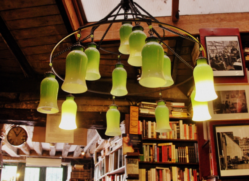 green chandelier bookstore books shakespeare and co (c) Kristin Espinasse