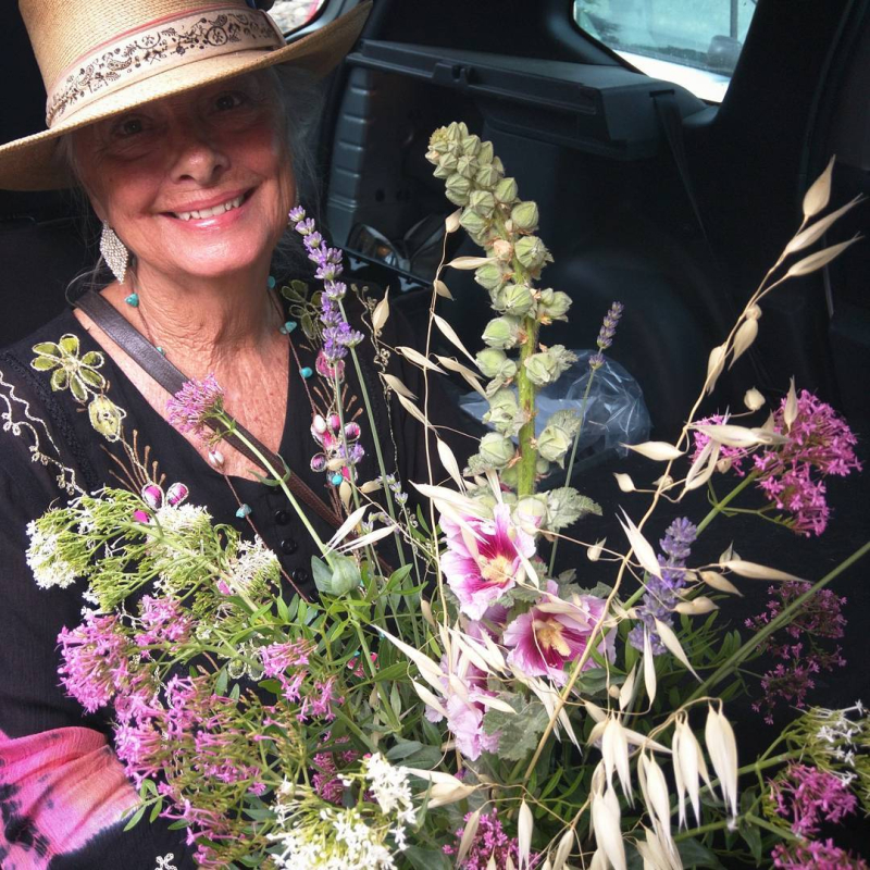 Mama Jules with the bouquet she made