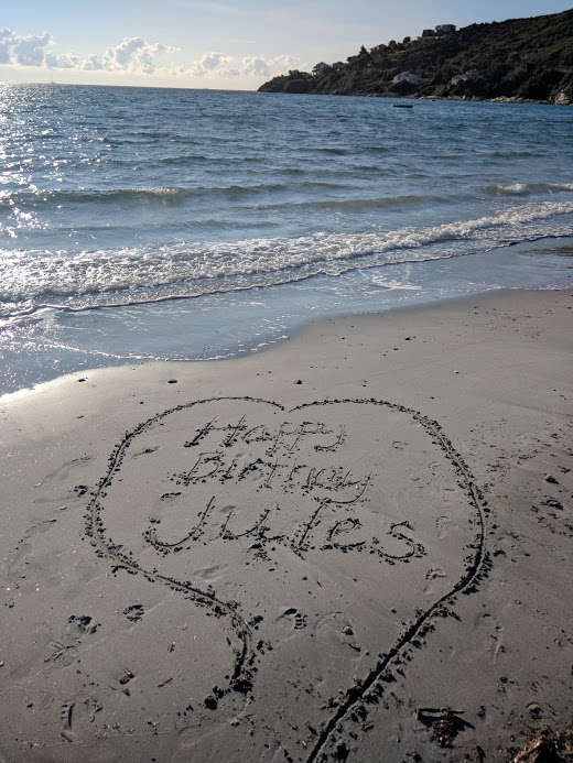 Happy Birthday Jules message on the sandy beach in Corsica France