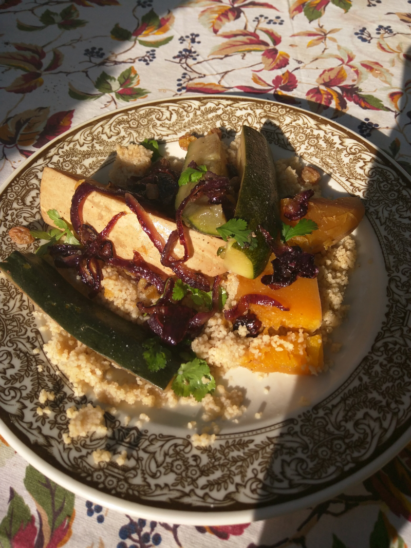 Vegetarian couscous morocco pumkin zuccini grains raisins onion honey garlic tablecloth