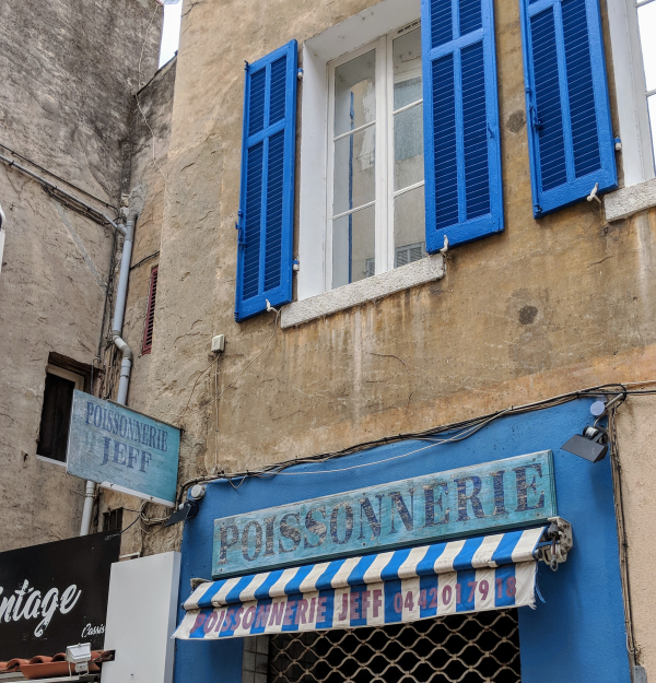 Poissonnerie fishmonger in Cassis France blue shutters striped awning charm