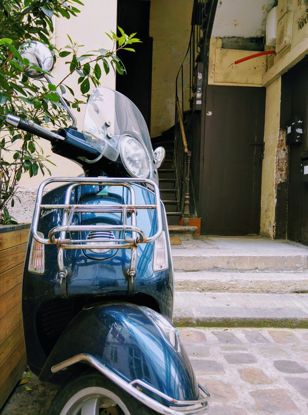 Midnight blue vespa scooter in Paris