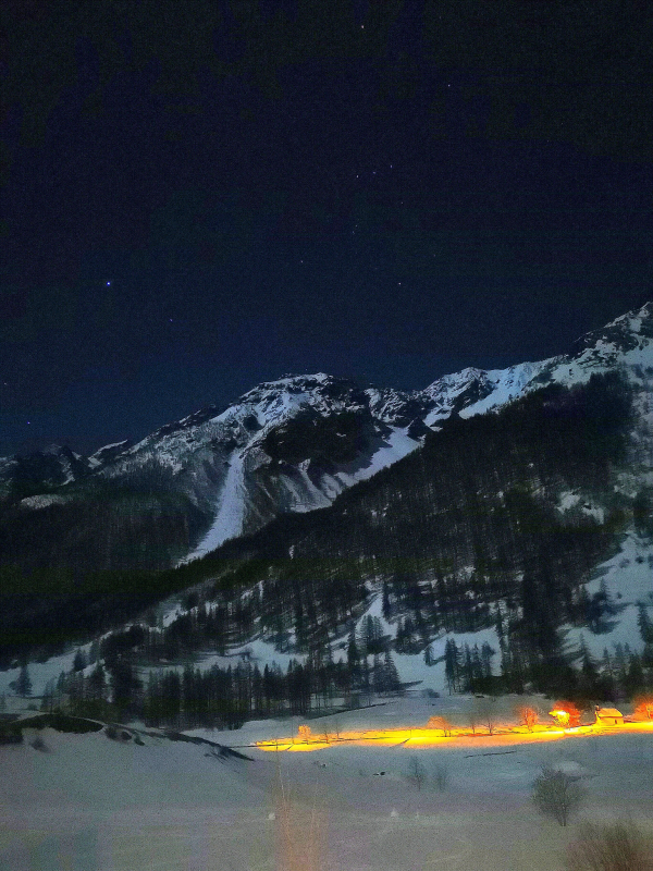 Four bright stars above Serre Chevalier alps mountains