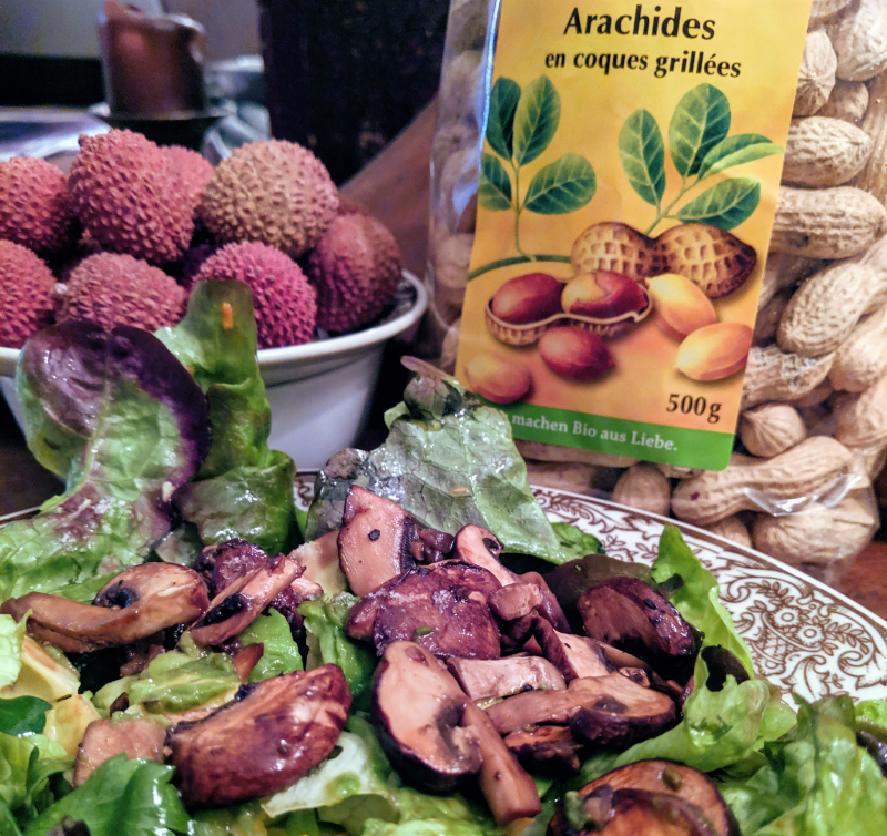 Lychees peanuts in shell and salad
