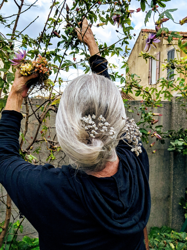 Mom picking passiflora flowers