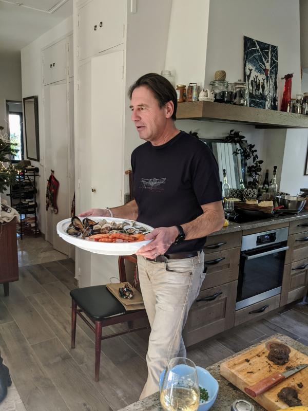 Jean-Marc serving seafood