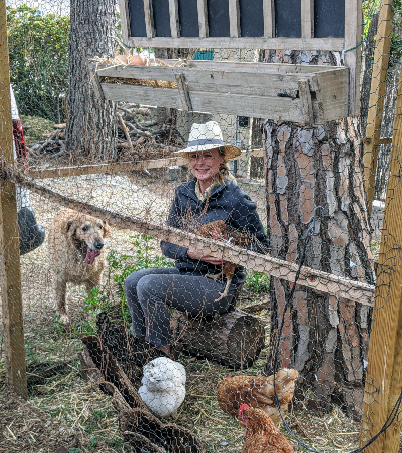 Kristi in the pen with chickens and Smokey