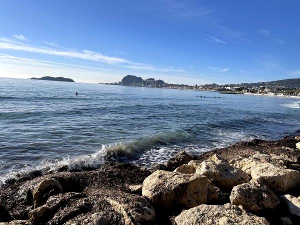 Walking in the sea in winter wetsuit